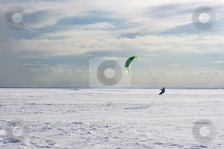Sail boarding stock photo, Green Sail on a cloudy day by Yann Poirier