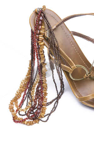 Shoe and jewelery stock photo, Brown high heels with necklace by Yann Poirier