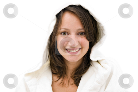 Woman with hood stock photo, Young natural looking smiling brunette woman wearing a white bathrobe with hood on a bright background by Corepics VOF