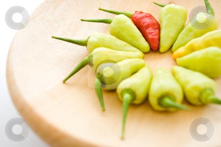 Red and yellow chili stock photo, Arrangement of red and yellow chili on a wooden plate - diversity by R. Eko Bintoro