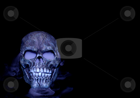 Steaming skull stock photo, A Halloween prop skull with fog coming from it's eyes and nose. by Cora Reed