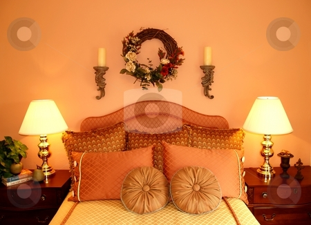Bedroom stock photo, A bedroom nicely fitted with bed side tables and pillows by Cora Reed