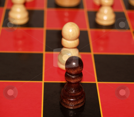 Two Pawns stock photo, Two pawns face off on a red and black chess board by Cora Reed