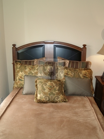 Bed stock photo, Bed with wood and leather head board by Cora Reed