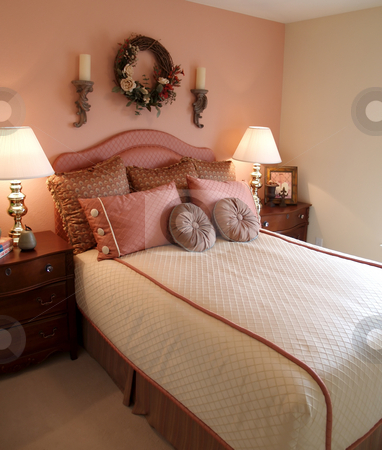 Pink bedroom stock photo, Pretty bedroom in pink with side tables by Cora Reed