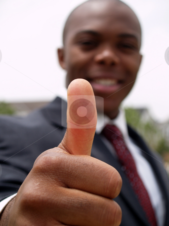 Thumbs up stock photo, African american man in a suit giving the thumbs up by Cora Reed