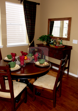 Dinner table stock photo, Typical dining room with hard wood floors by Cora Reed
