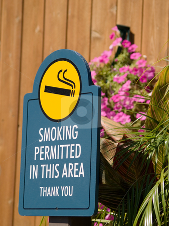 Sign stock photo, A sign for a smoking permitted area by Cora Reed