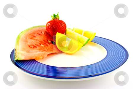 Watermelon with Citrus Slices and Strawberry stock photo, Slice of red juicy watermelon with lemon, lime and orange wedges and single strawberry on a blue plate with a white background by Keith Wilson