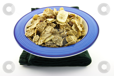 Bran Flakes in a Blue Bowl stock photo, Crunchy delicious looking bran flakes in a blue bowl and a black napkin on a white background by Keith Wilson