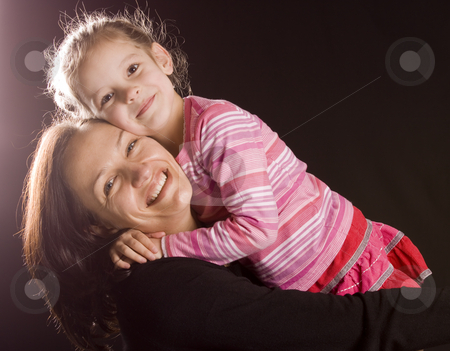 Mum and daughter stock photo, Mother and her daughter hugging each other by Jandrie Lombard