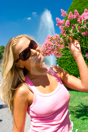 Girl with flowers stock photo, Beautiful blonde girl with pink flowers in Istantul garden by Dmitry Rostovtsev