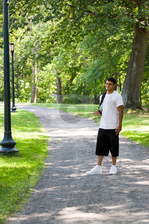 Going Back to School stock photo, A young man walking on campus with his backpack and a positive attitude. by Todd Arena
