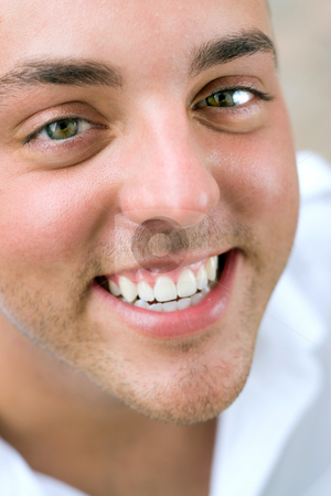 Happy Smiling Man stock photo, Closeup of the face of a happy young man with incredibly white teeth. by Todd Arena
