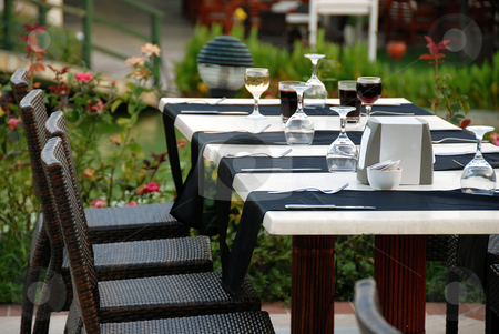 Table for dinner stock photo, Outdoor table with served plate and wine glasses by Julija Sapic