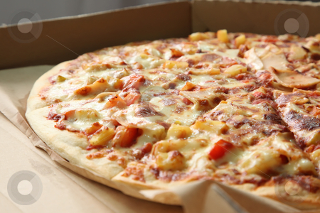 Whole pizza stock photo, Whole hawaiian pizza with pinapple in fast food box by Kheng Guan Toh