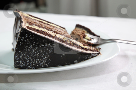 Chocolate cake stock photo, Chocolate fudge cake layered with icing and cream by Kheng Guan Toh