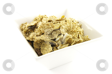Cornflakes stock photo, Golden crisp cornflakes in a square white bowl with a white background by Keith Wilson