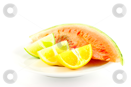 Citrus Fruit and Watermelon stock photo, Lemon, lime and orange wedges with a slice of juciy watermelon on a white background by Keith Wilson