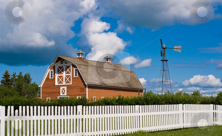Barn Yard stock photo, A old red barn along with a weather vane shot behind a white picket fence by Richard Nelson