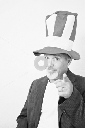 Middle aged man with tall top hat pointing finger at camera. stock photo, Middle aged man with tall top hat pointing finger at camera. by Gregory Dean