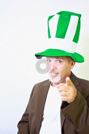 Middle aged man with tall green and white top hat pointing finger at camera. stock photo, Middle aged man with tall green and white top hat pointing finger at camera. by Gregory Dean