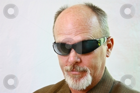Man with sunglasses and slight smirk on his face. stock photo, Man with sunglasses and slight smirk on his face. by Gregory Dean