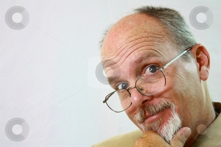 Happy man with glasses on his nose. stock photo, Happy man with glasses by Gregory Dean