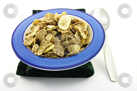 Bran Flakes in a Blue Bowl stock photo, Crunchy delicious looking bran flakes in a blue bowl with a spoon and a black napkin on a white background by Keith Wilson