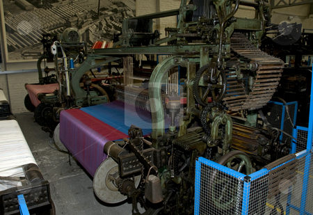 Very old loom stock photo, The  cotton on the big loom to make textile by Chris Willemsen