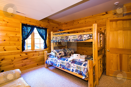 Close up on a Bedroom in a Cabin stock photo, Close up on a Bedroom in a Log Cabin by Mehmet Dilsiz