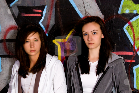 Teeangers Posing stock photo, Teenagers Posing while leaning against the wall by Mehmet Dilsiz