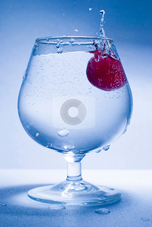 Freeze motion grape and glass water stock photo, Grape fall into glass water, froze motion by Lawren