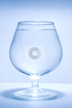 Glass water and little bubbles stock photo, Glass full of clear water by Lawren