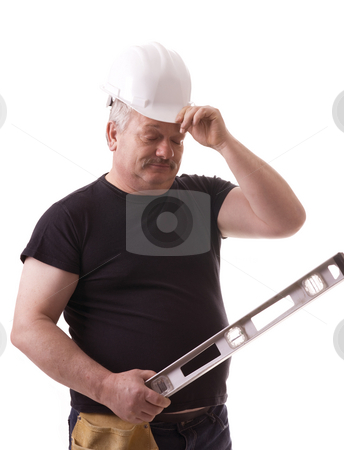Worker stock photo, Contractor on the job trying to solve problem by Marek Poplawski