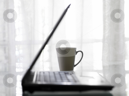 Laptop and cup of coffee  stock photo, Shot of laptop and cup of coffee by eskaylim