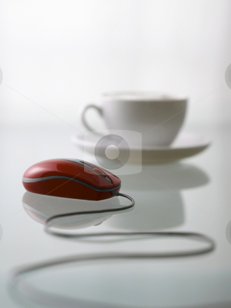Cup and mouse stock photo, Selective focus of cup of coffee and mouse by eskaylim