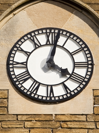 White clock 2 stock photo, A black and white clock with roman numerals on a church tower by Mike Smith