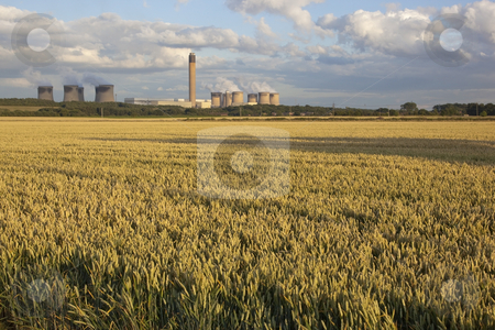 Power station with wheat fields stock photo, A power station with wheat fields in summer by Mike Smith