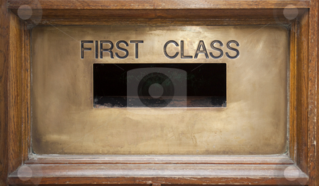First class mail box  stock photo, Old brass mail box in timber surround by Mike Smith