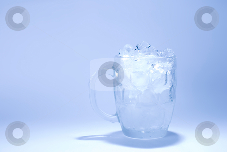 Glass full of ice cube stock photo, The glass full of ice cube with blue background by Lawren