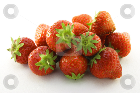Pile of Strawberries  stock photo, Juicy ripe red strawberries on a white background by Keith Wilson