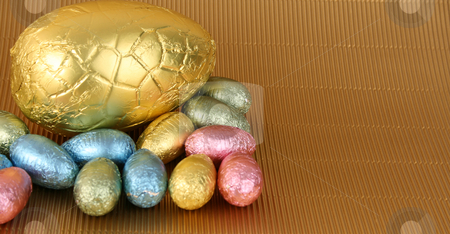 Easter Eggs stock photo, Various colors and shaped easter eggs on a gold background by Vanessa Van Rensburg