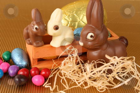 Easter Eggs stock photo, Various colors and shaped easter eggs and bunnies on a gold background by Vanessa Van Rensburg
