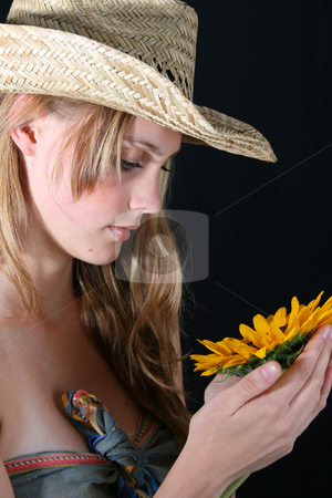 Female Model stock photo, Beautiful young female model holding a sunflower by Vanessa Van Rensburg