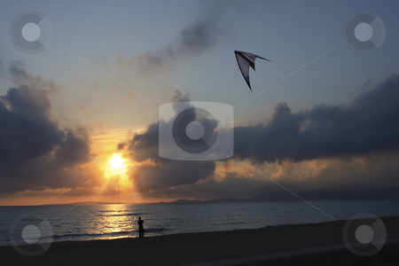 Kite flying in Mallorca Spain at sunset stock photo, Kite flying in Mallorca Spain at sunset by Sharron Schiefelbein