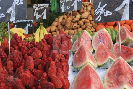 Fruit stand with Strawberries and watermelon stock photo, Fruit stand with Strawberries and watermelon by Sharron Schiefelbein