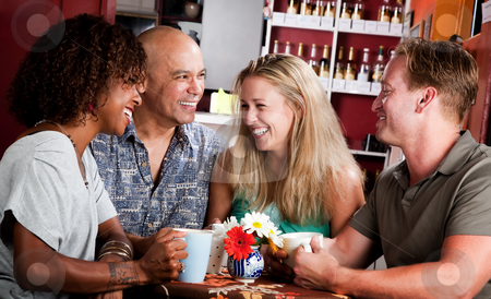 Friends in a Coffee House stock photo, Four adult friends meeting in a coffee house by Scott Griessel