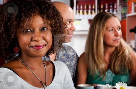 African American Woman with Friends stock photo, Pretty African American Woman in Coffee House with Friends by Scott Griessel