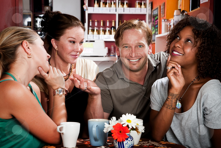 Man with three pretty women in coffee house stock photo, Man with three pretty women in coffee house by Scott Griessel